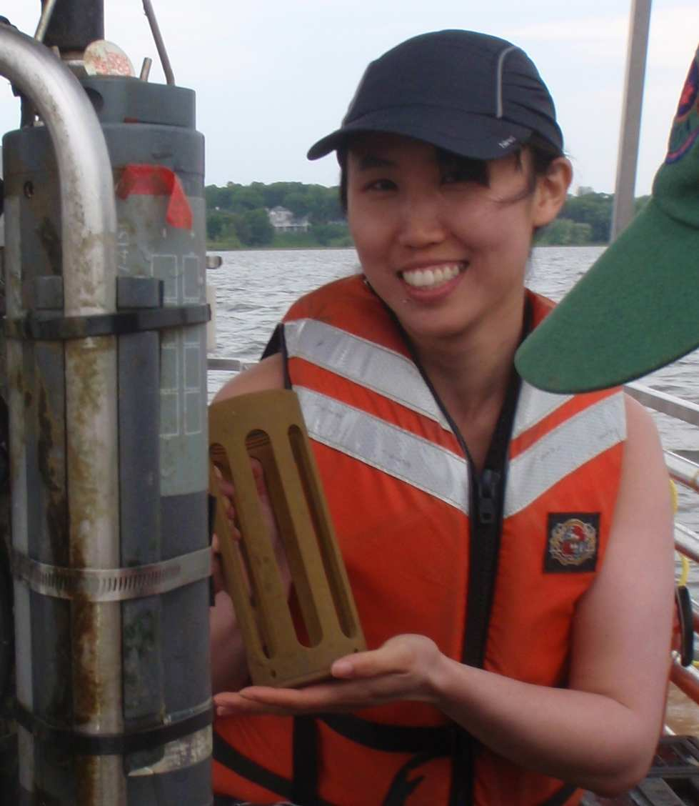 Vingie Ng holds a sonde cage next to subsurface sensors
